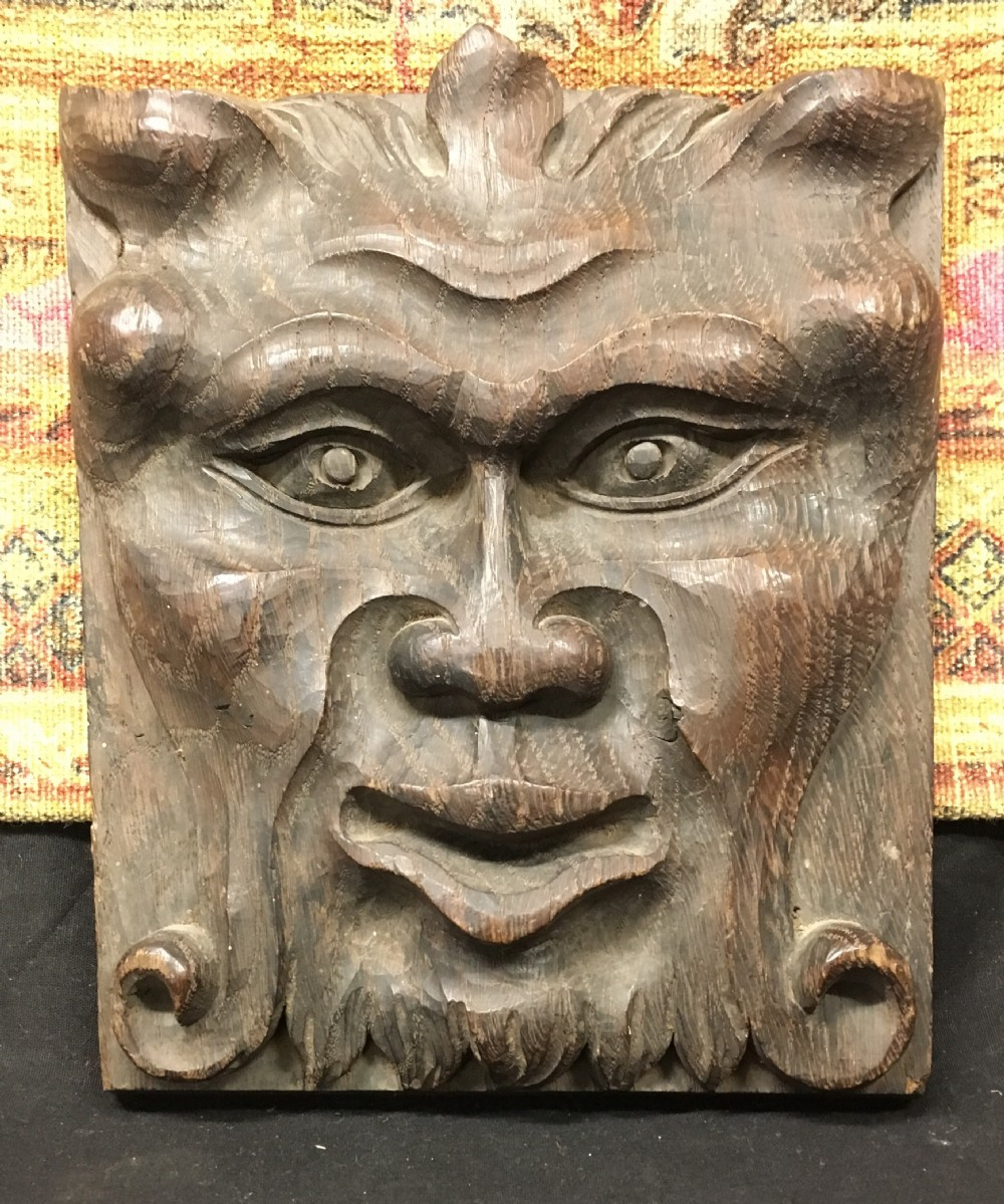 c18th oak carving of satyrs face