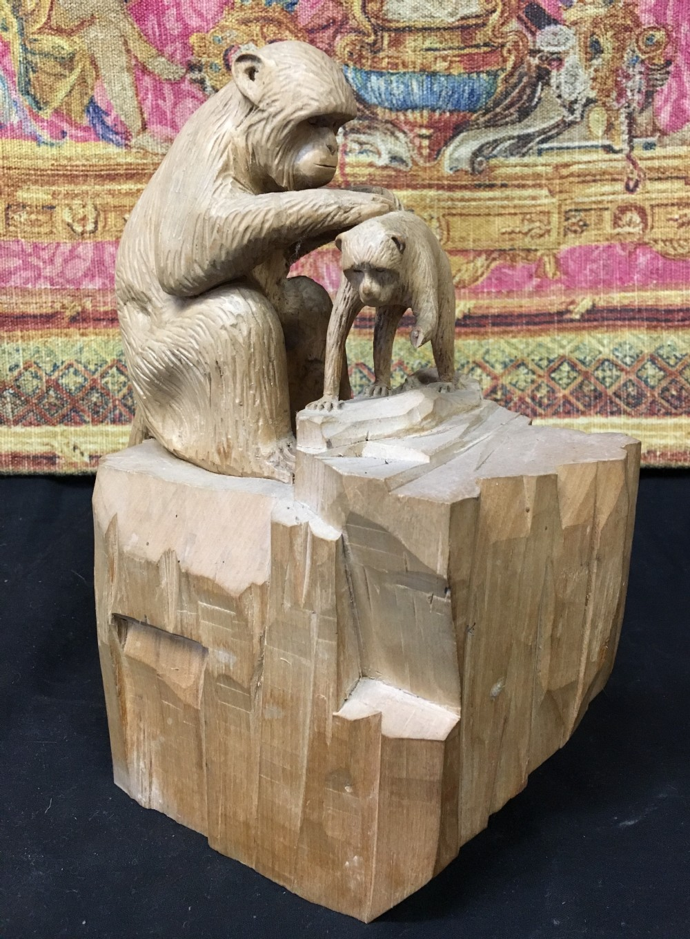 c20th limewood carving of a monkey tending its baby