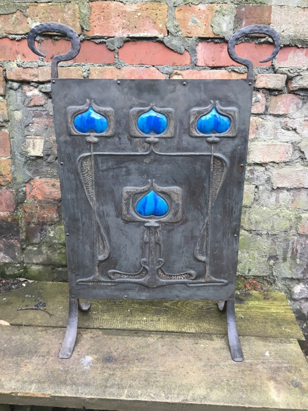 arts and crafts steel fire screen with ceramic heart inlays
