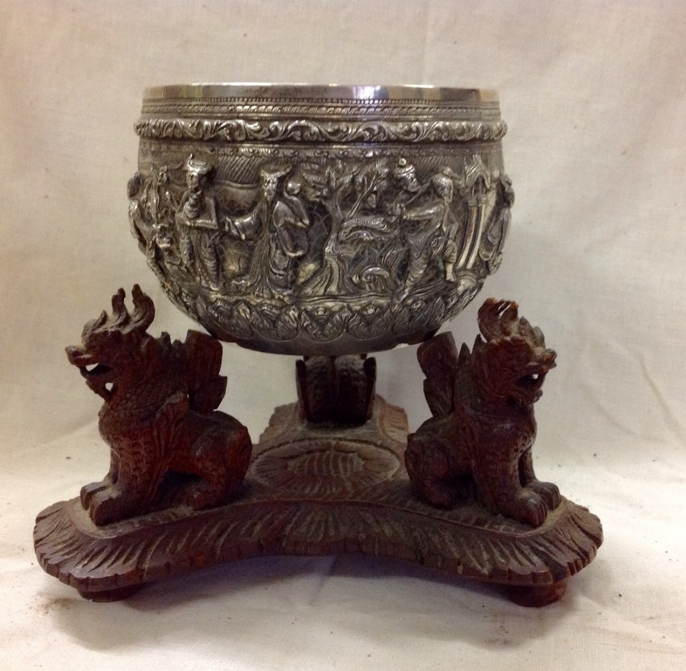 c19th burmese silver cast bowl on a wooden stand
