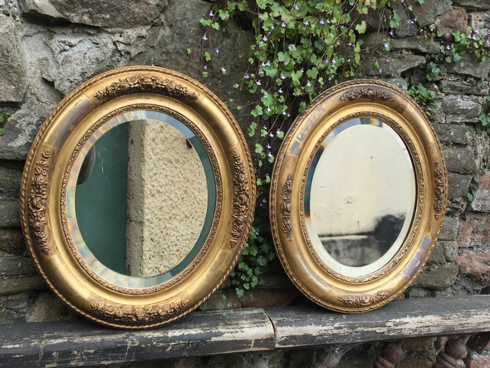 c19th matched pair of small oval mirrors