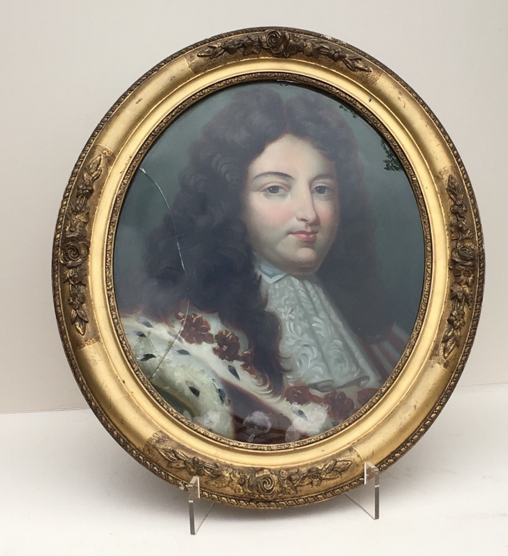 c19th portrait of a nobleman painted on glass in an oval frame