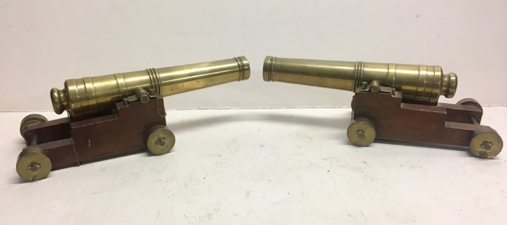 a pair of desktop model brass cannons