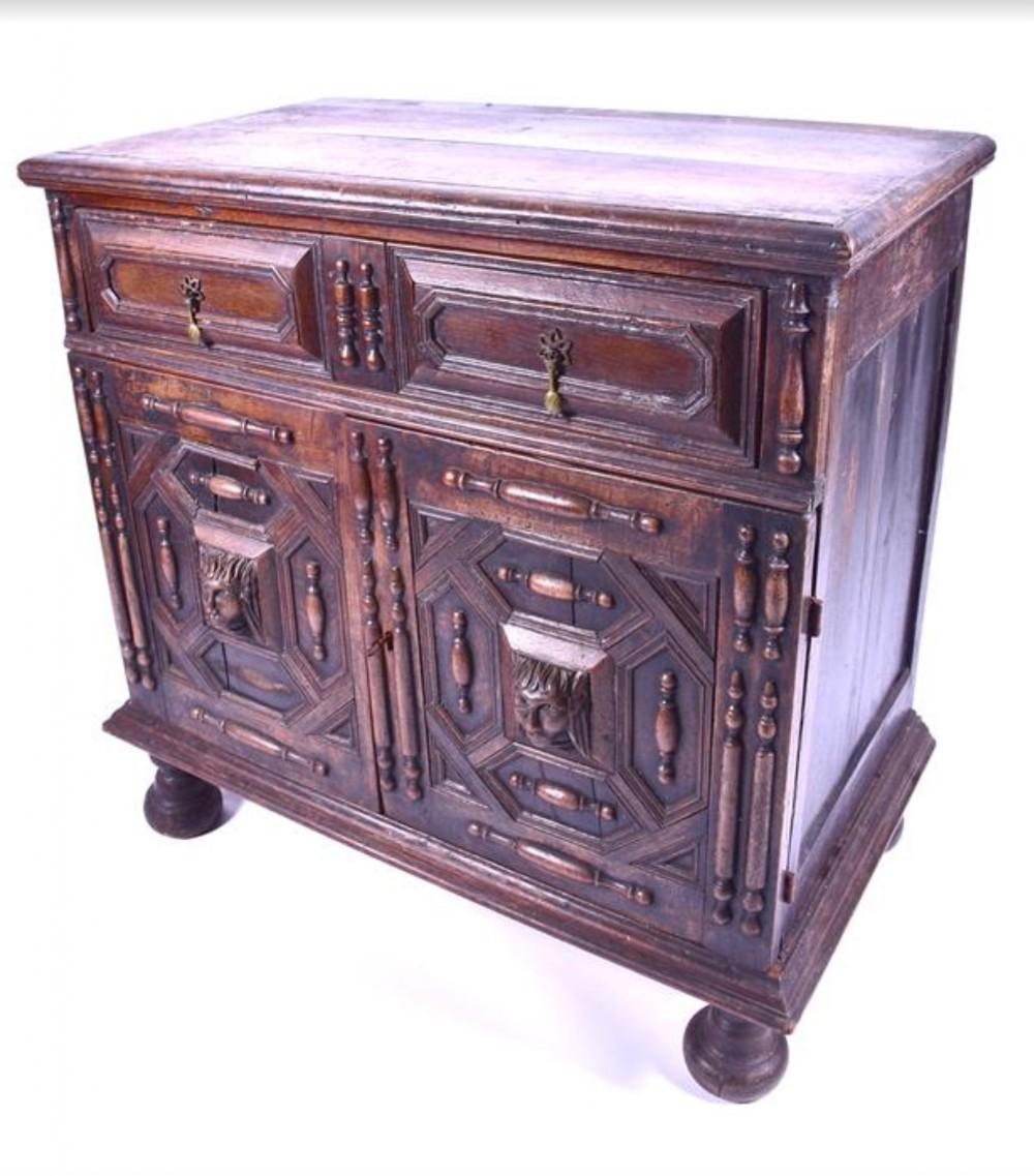 a late c17th oak cupboard 95 cms wide