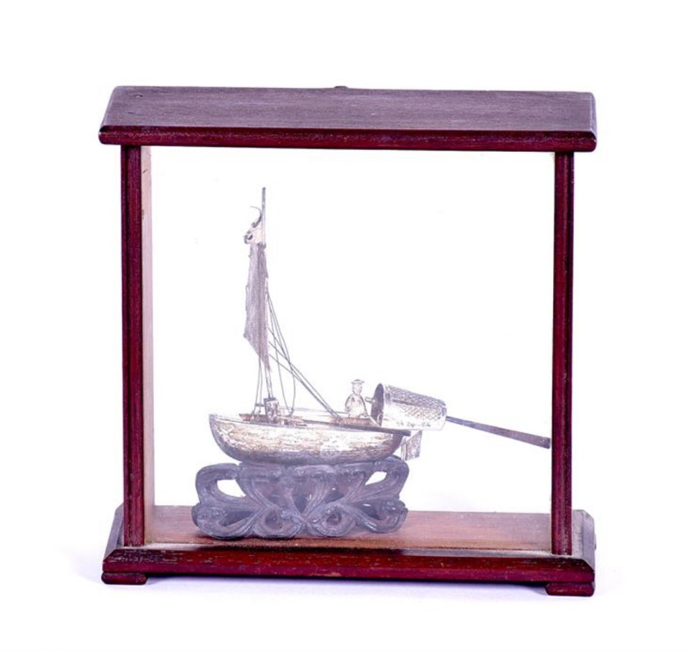small chinese white metal model of a chinese junk