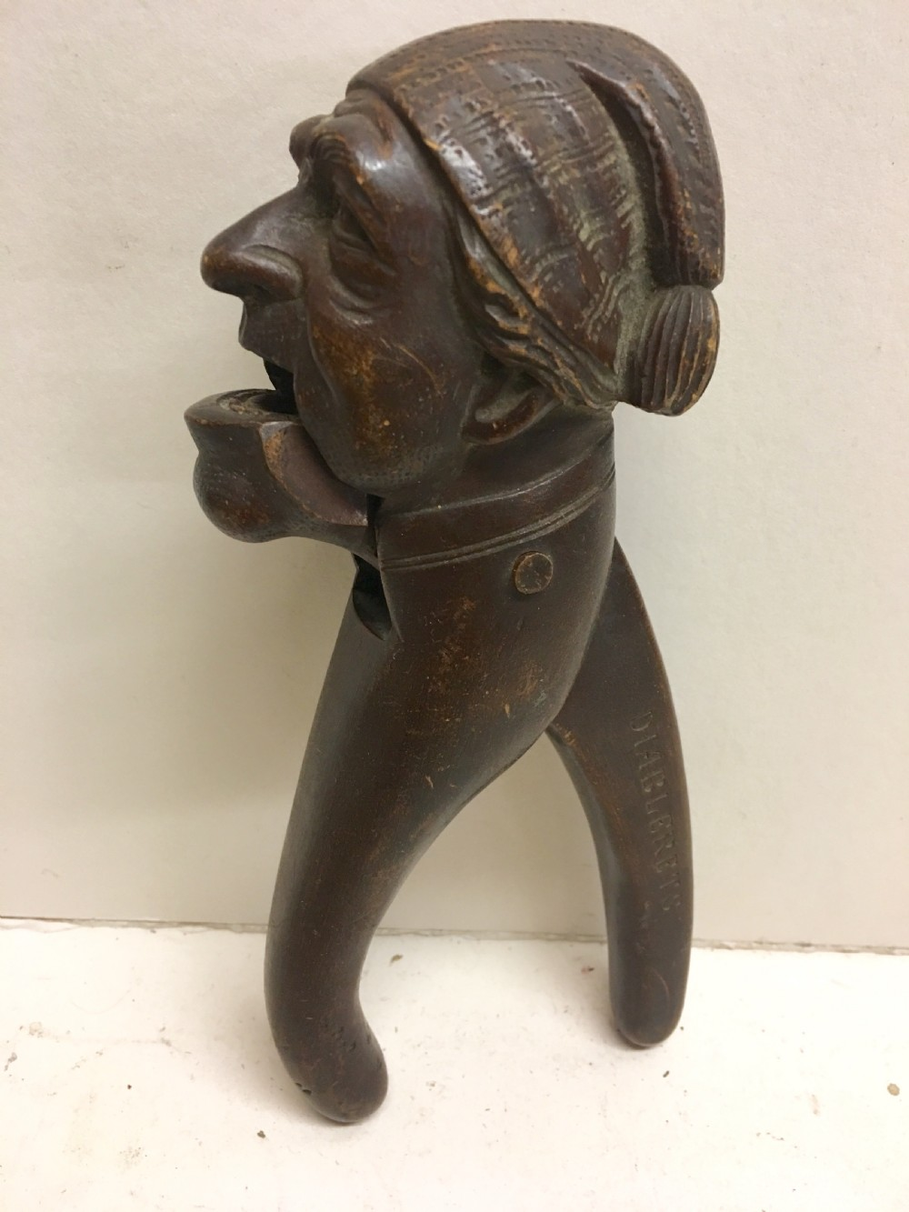 c19th swiss carving of a man modelled as a nut cracker