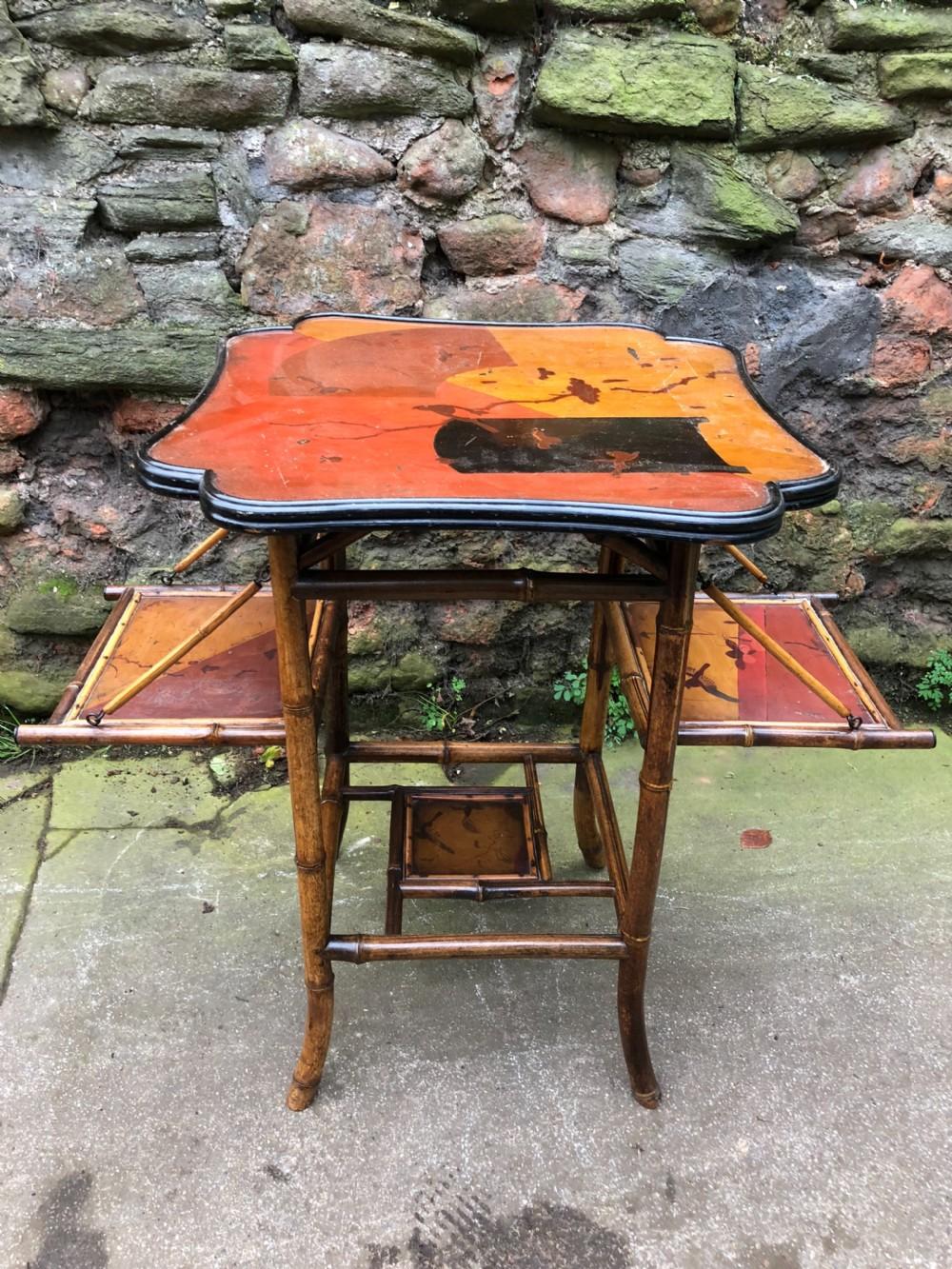 edwardian lacquered bamboo table with two adjustable shelves
