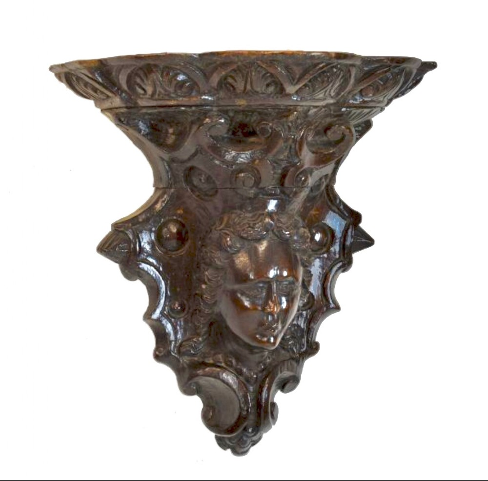 c17th carved figurative wall bracket