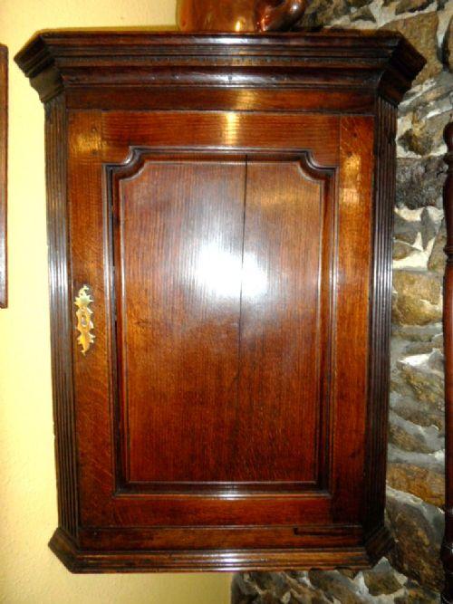 georgian oak raised panel fronted corner cupboard