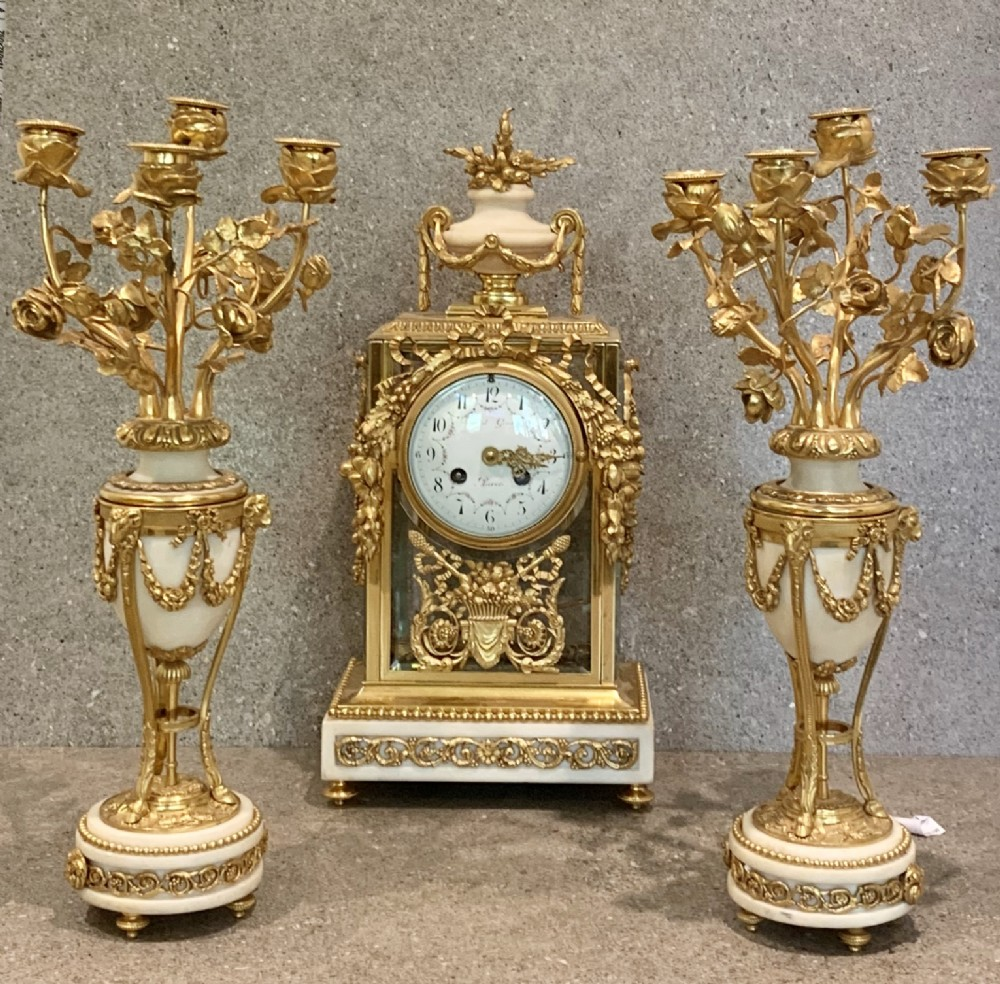 fine french gilt bronze four glass clock set by gerard paris early 19th century
