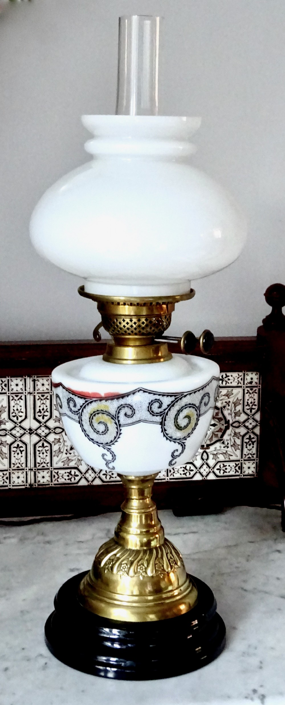 a glass and brass veritas oil lamp