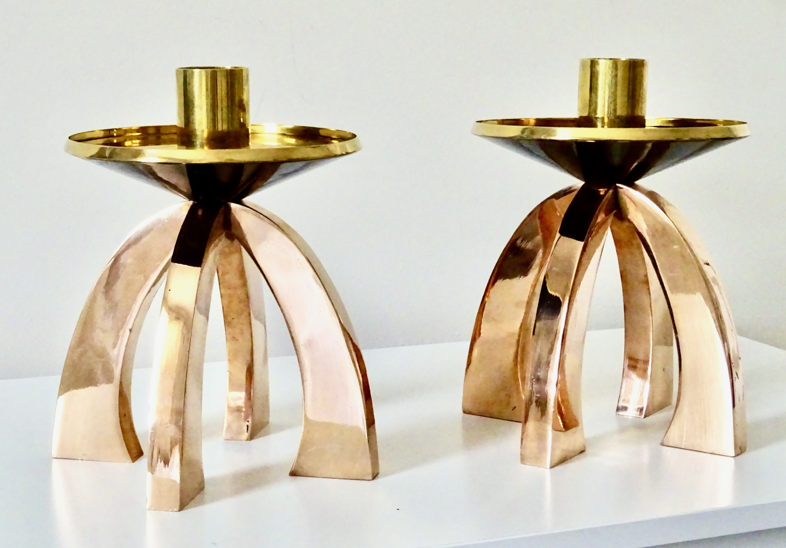 a pair of arts and crafts copper and brass candlesticks