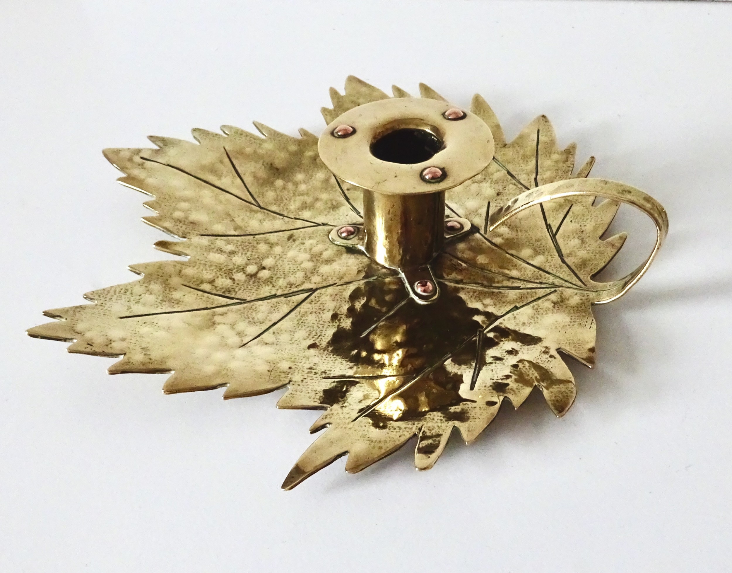 arts and crafts leaf shaped brass and copper candle holder