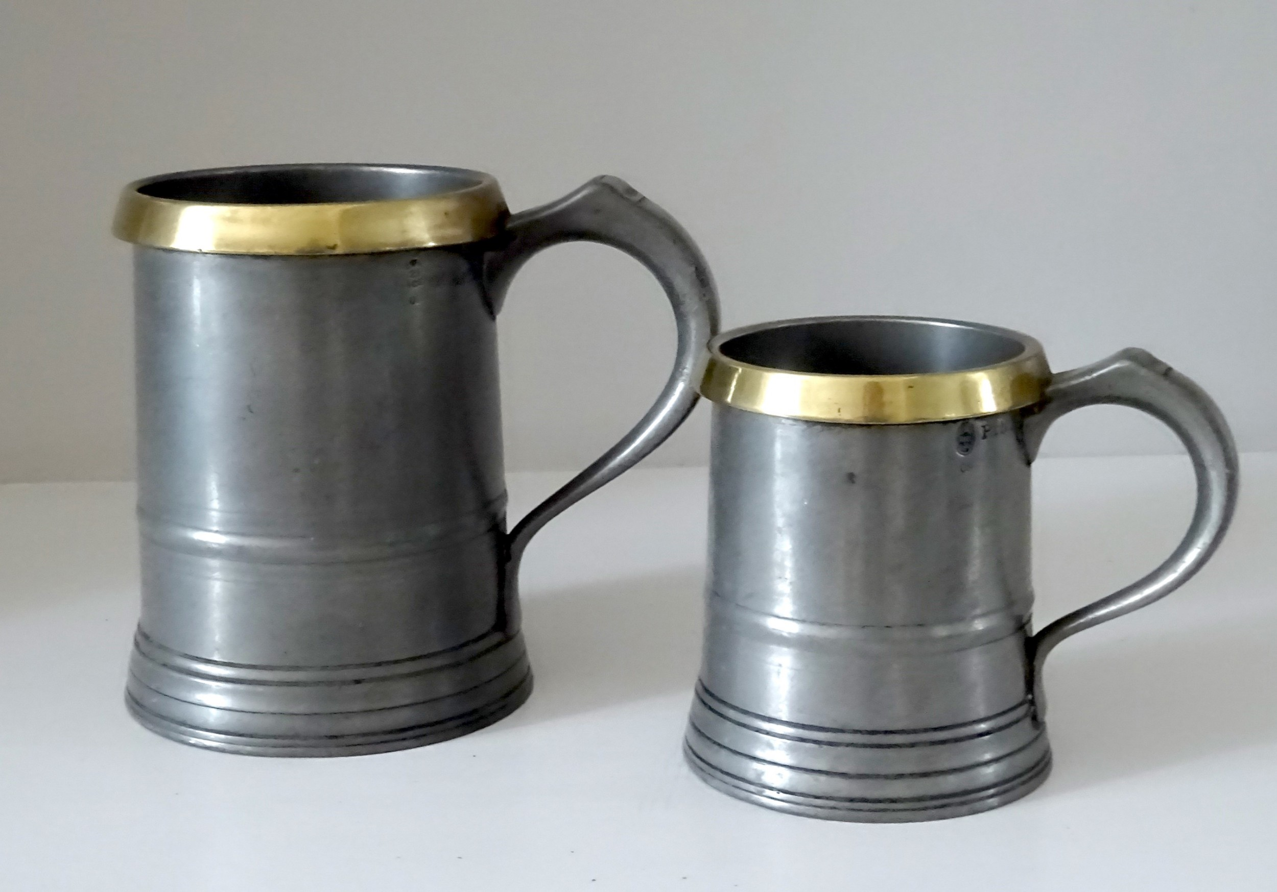 two loftus pewter tankards with brass rims