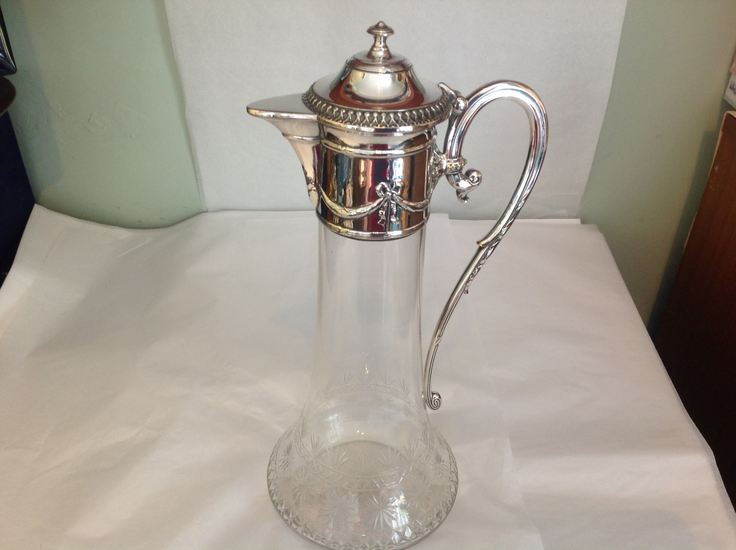elegant glass and silver plate ewer