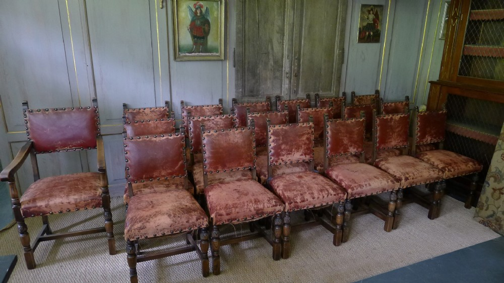 set of 19 early 20th century leather studded oak dining chairs
