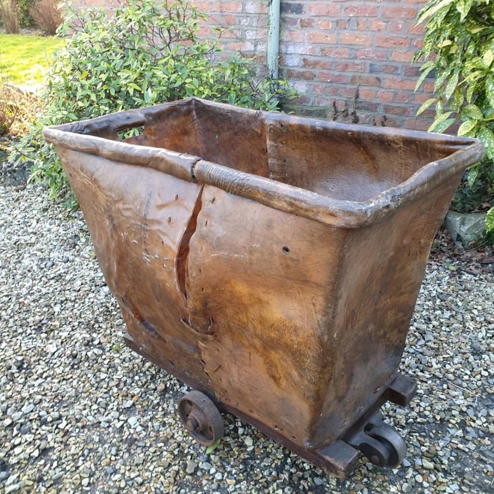 unusual 19thc country house leather laundry basket trolley