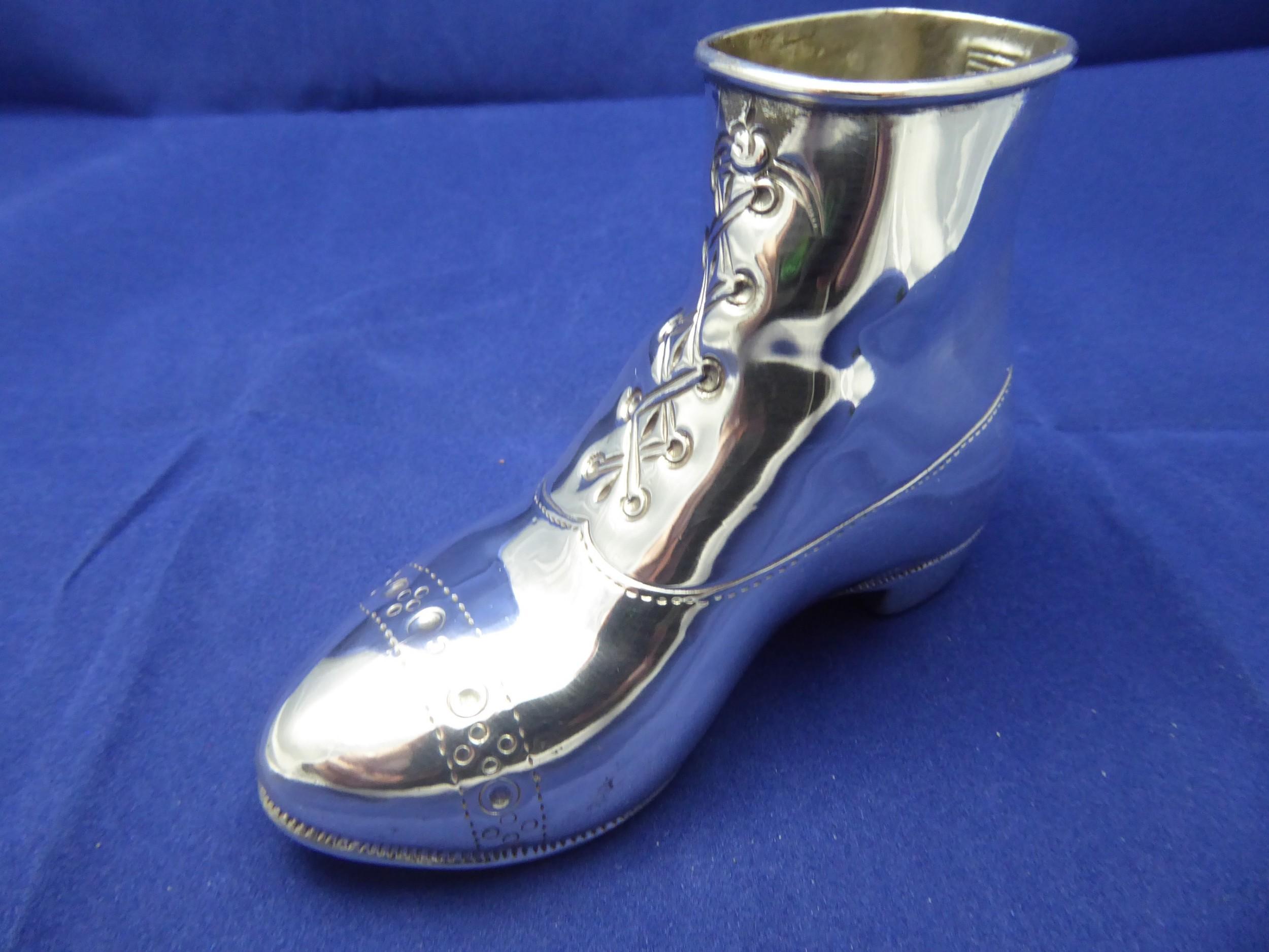 rare solid silver shoe striker
