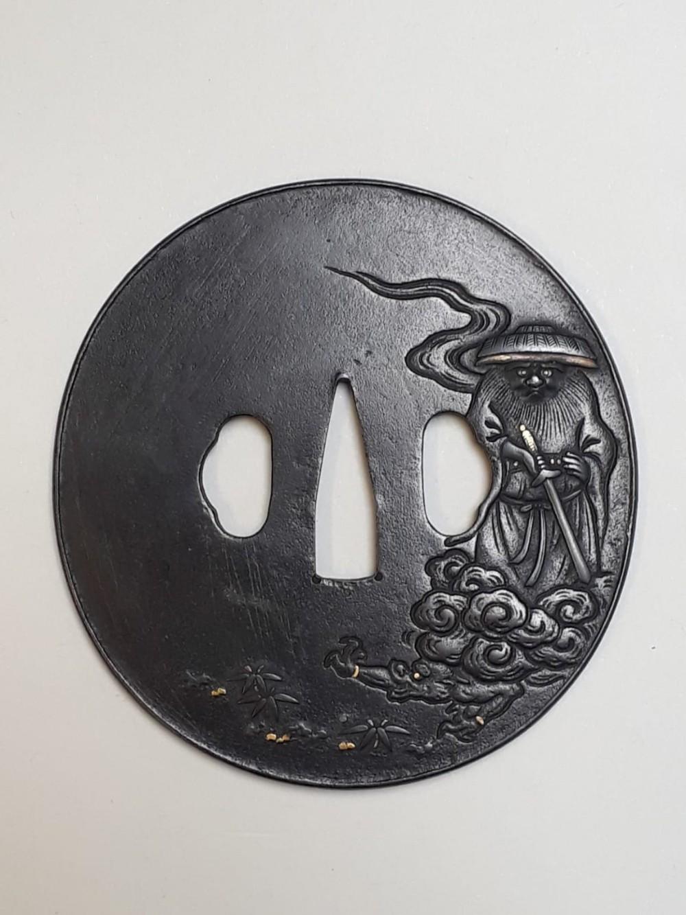 japanese iron tsuba with shoki decoration