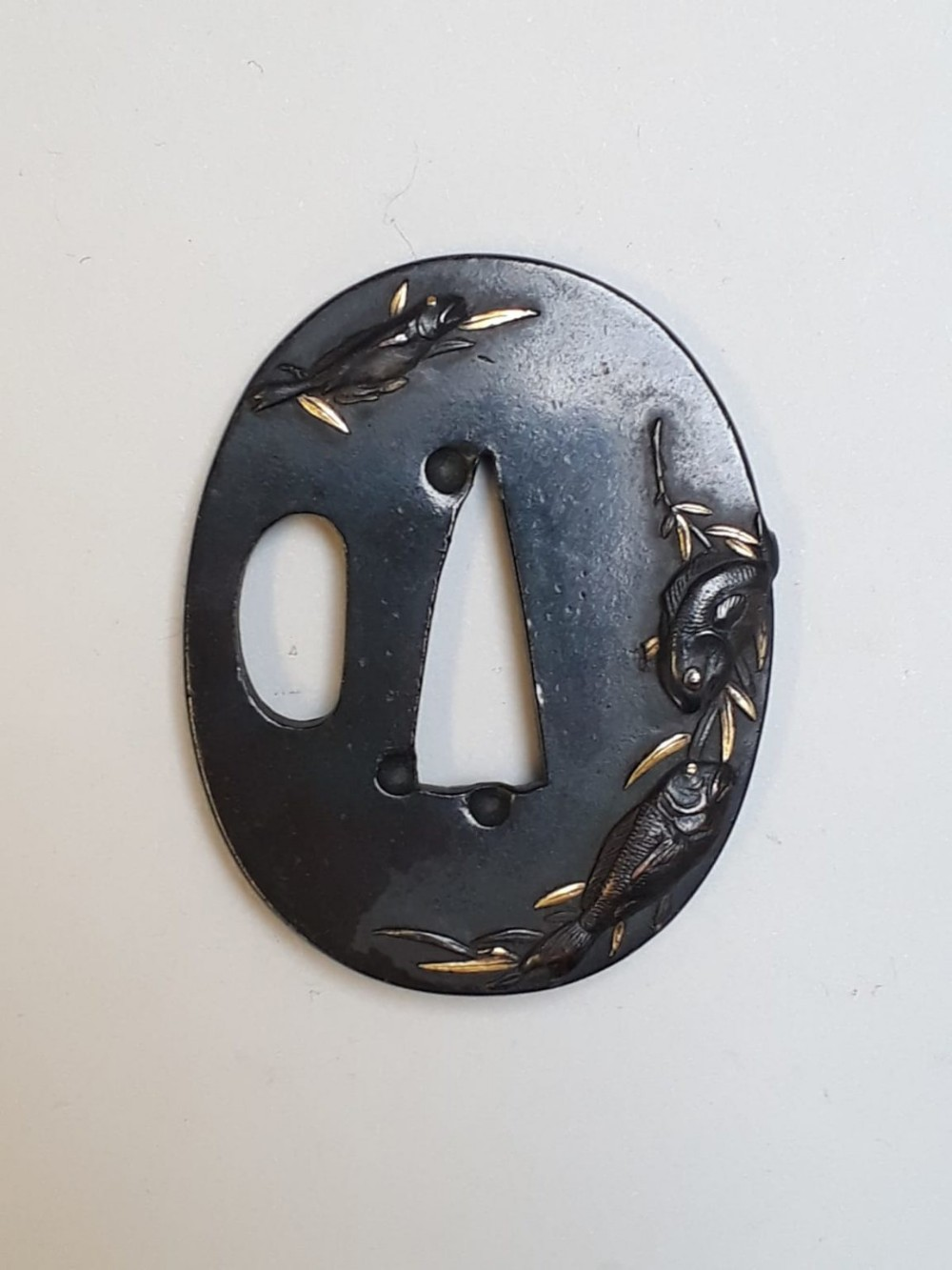 japanese iron tsuba decorated with fishes