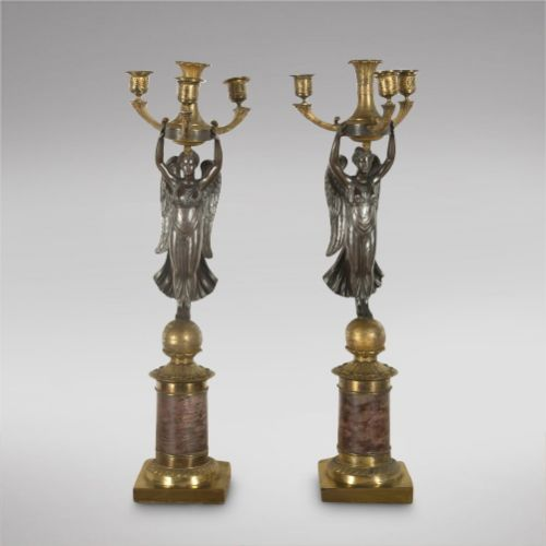 a pair of napoleonic french empire gilt and bronze candelabra