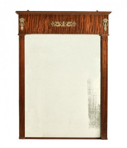 a mahogany and gilt metal large wall mirror in empire taste