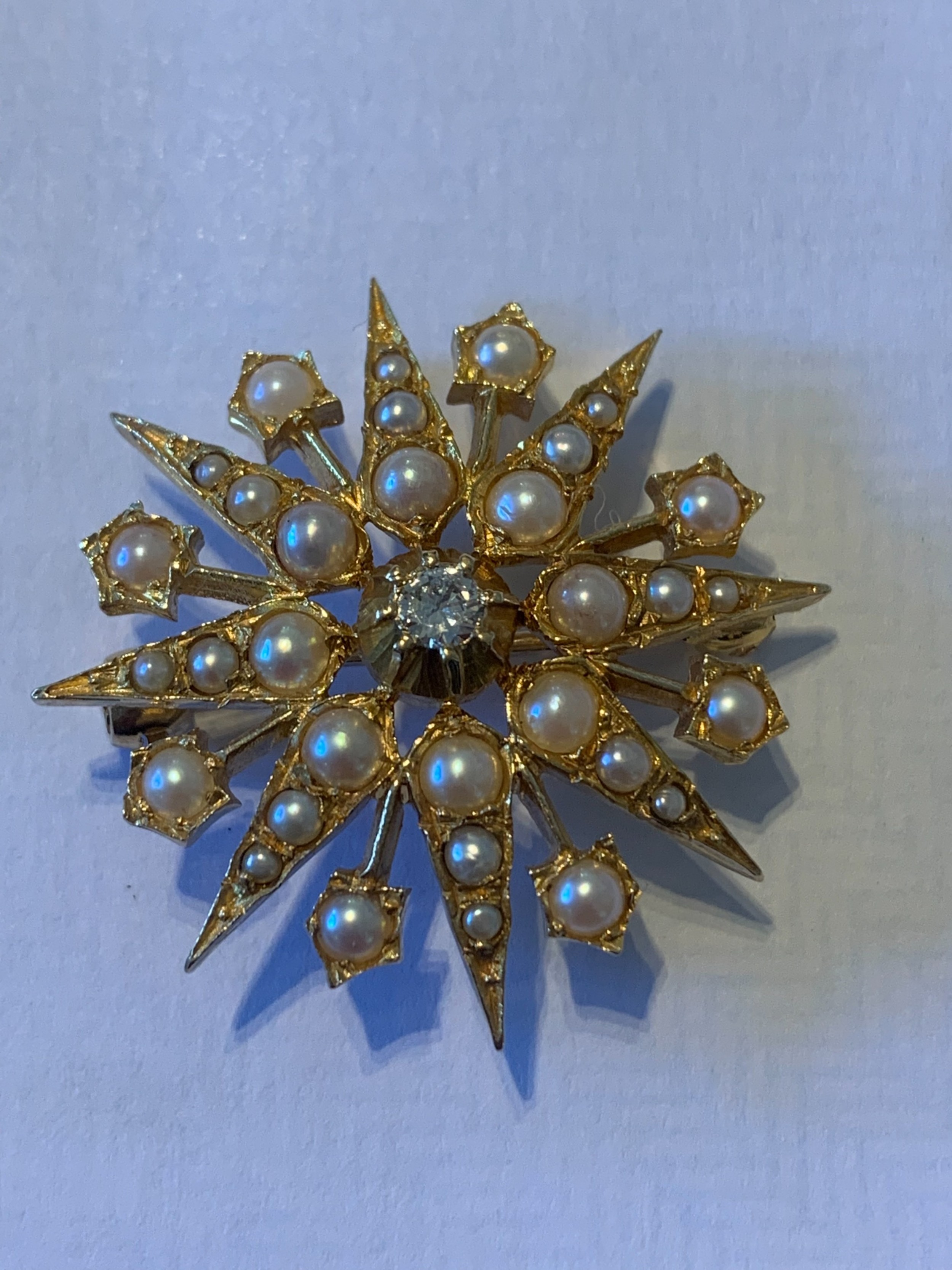 an edwardian diamond and pearl brooch