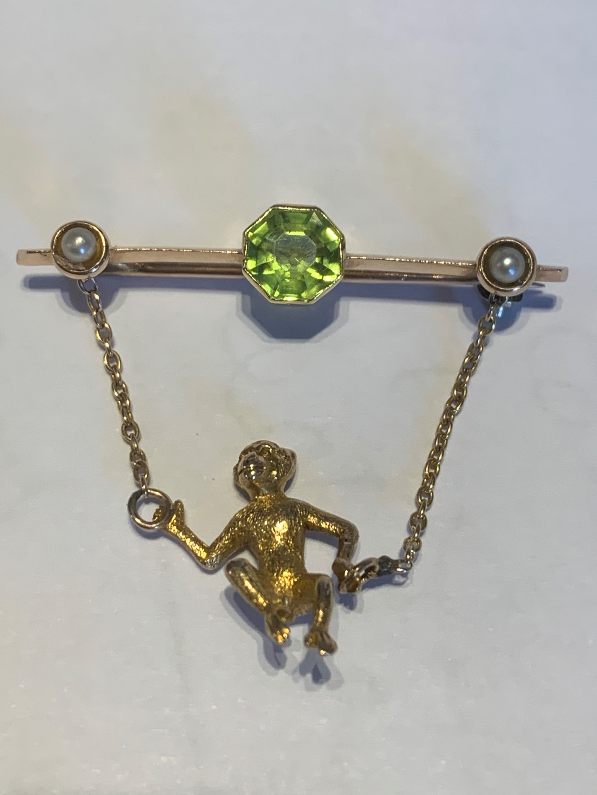peridot and pearl early 20th century gold monkey brooch