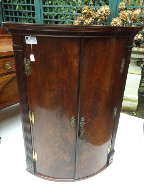 c18th george iii period mahogany bowfront corner cupboard
