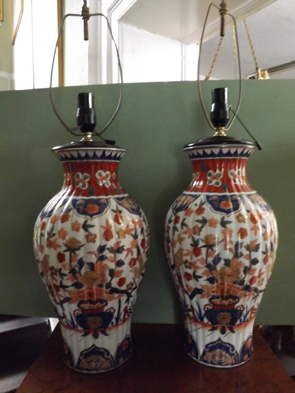 pair late c19th japanese imari porcelain vases now fitted with lamp conversions