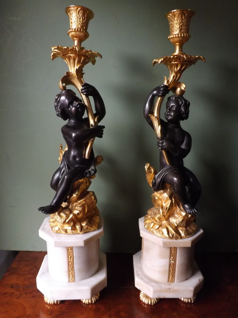 pair of late c19th french bronze and ormolu candlesticks on marble plinth bases
