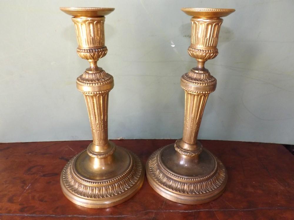 pair of c19th gilt bronze candlesticks