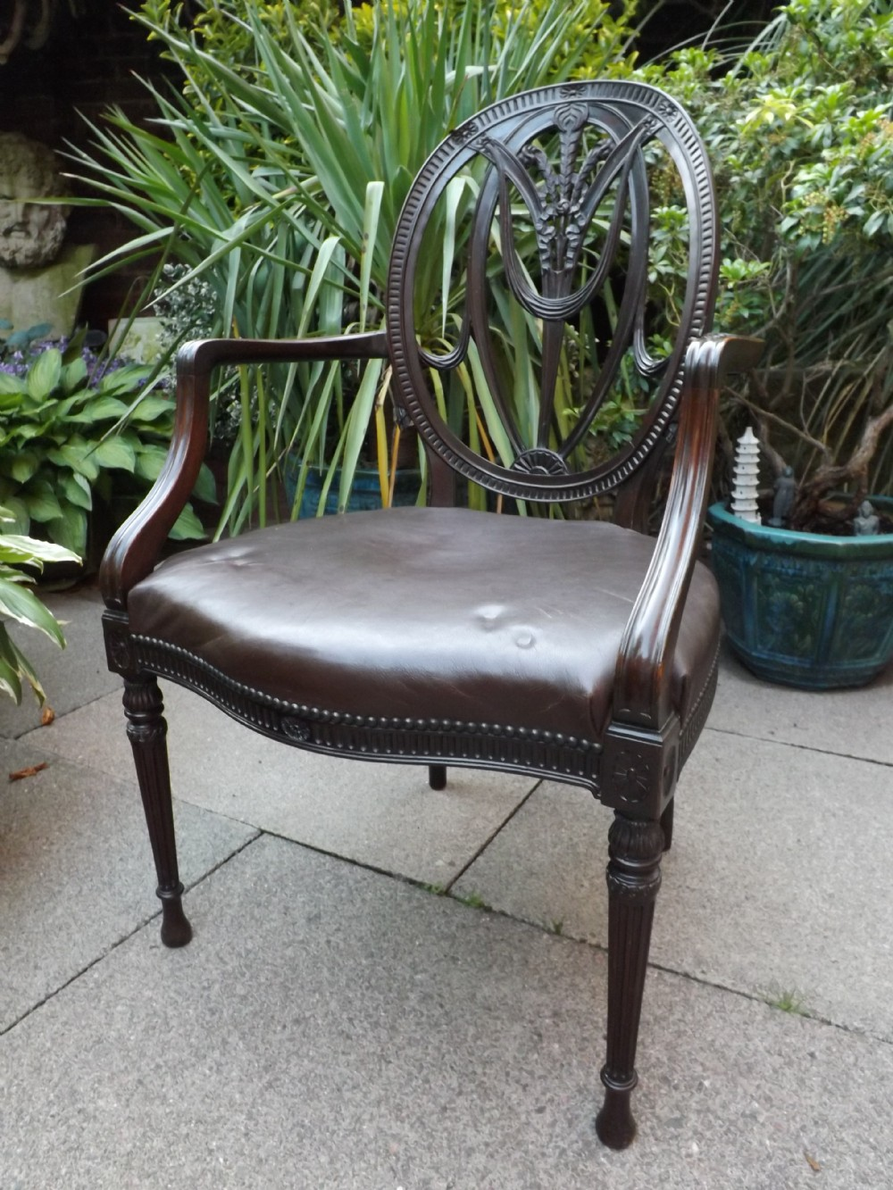 late c19thearly c20th carved mahogany armchair of adam revival design