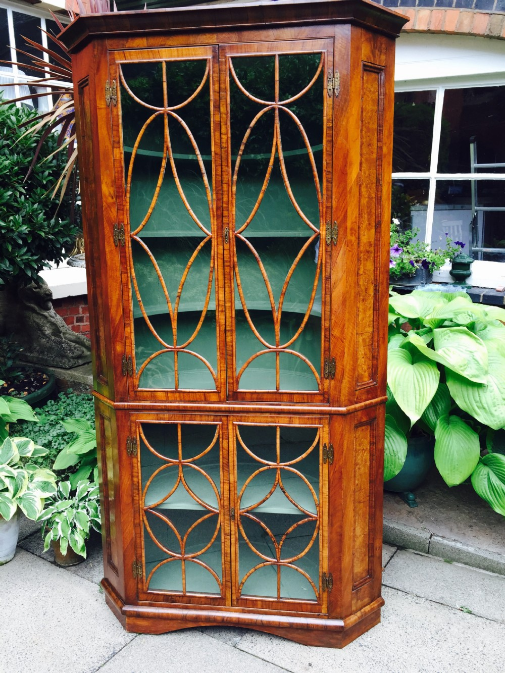 c19th george i revival walnut double cornercabinet with ovoid and diamond interlaced glazing