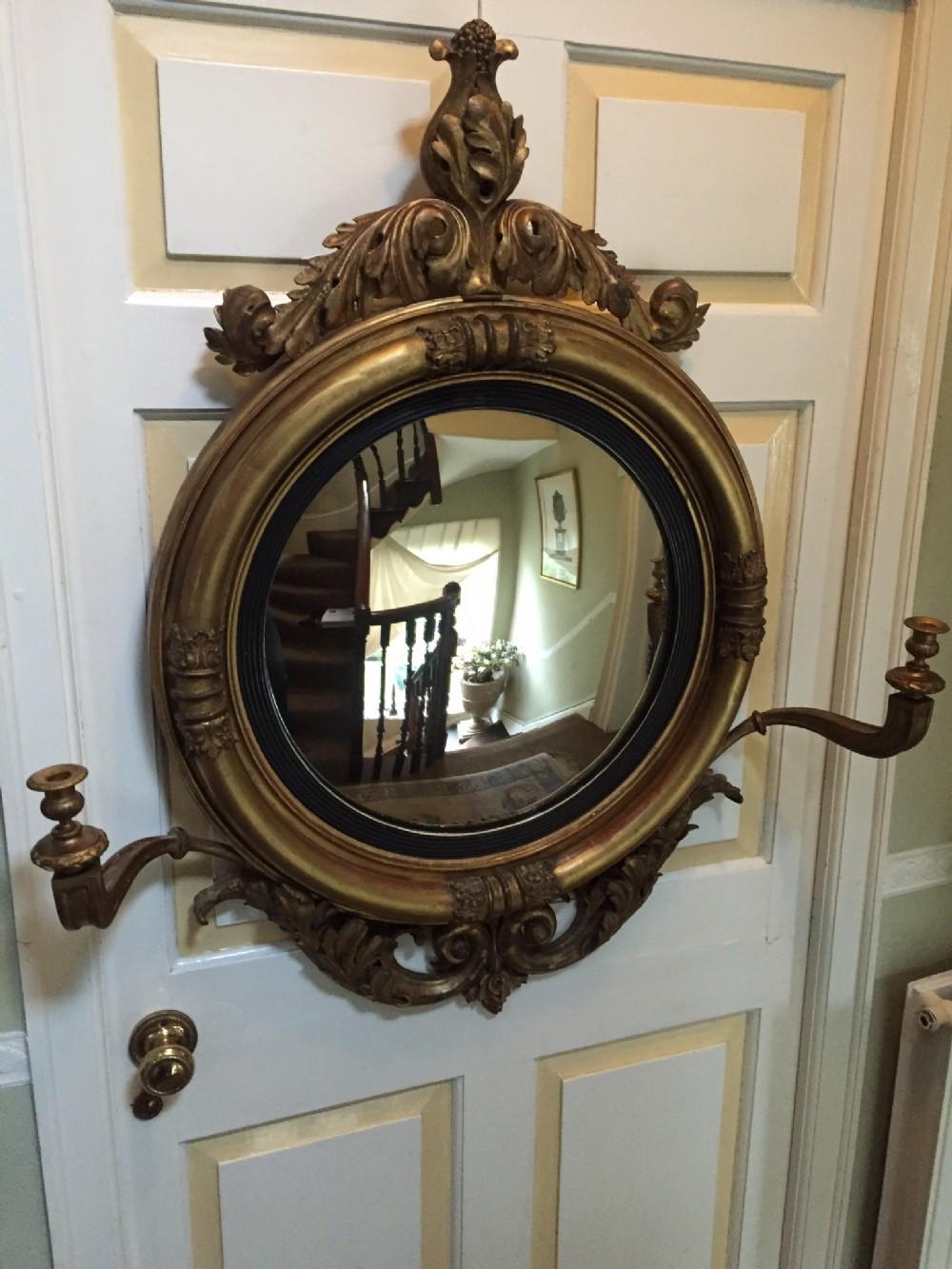 early c19th regency period carved giltwood framed 'girandole' convex plate mirror