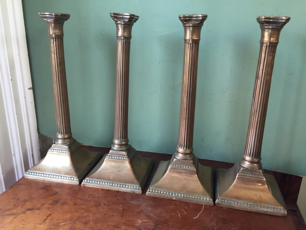 rare set of 4 c18th george iii period brass'bellmetal' reeded column candlesticks