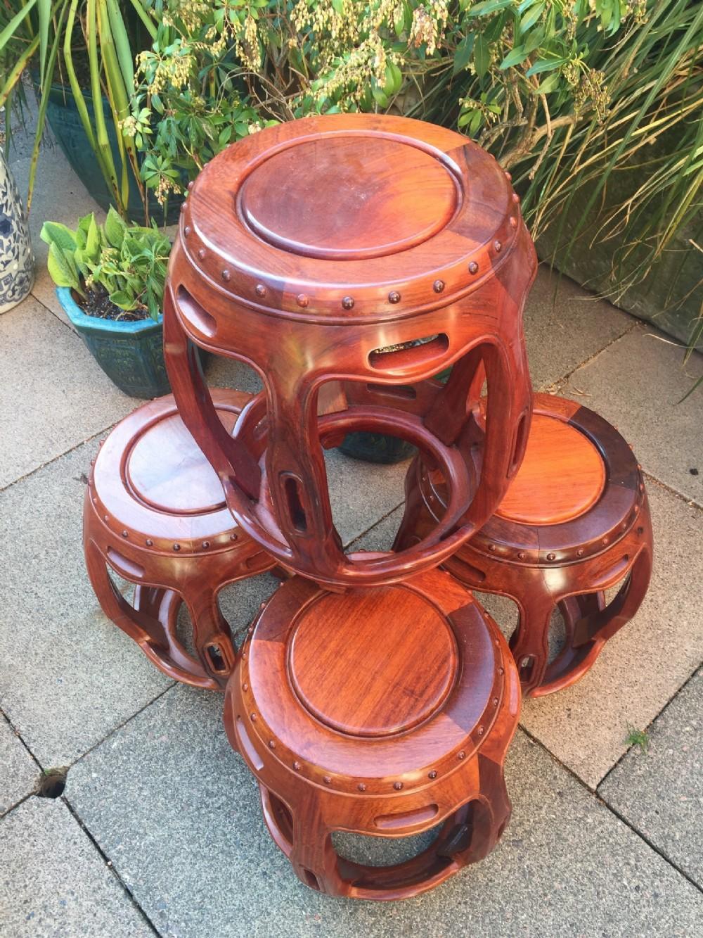 set of 4 c20th chinese design hardwood barrelshaped garden seats or side tables