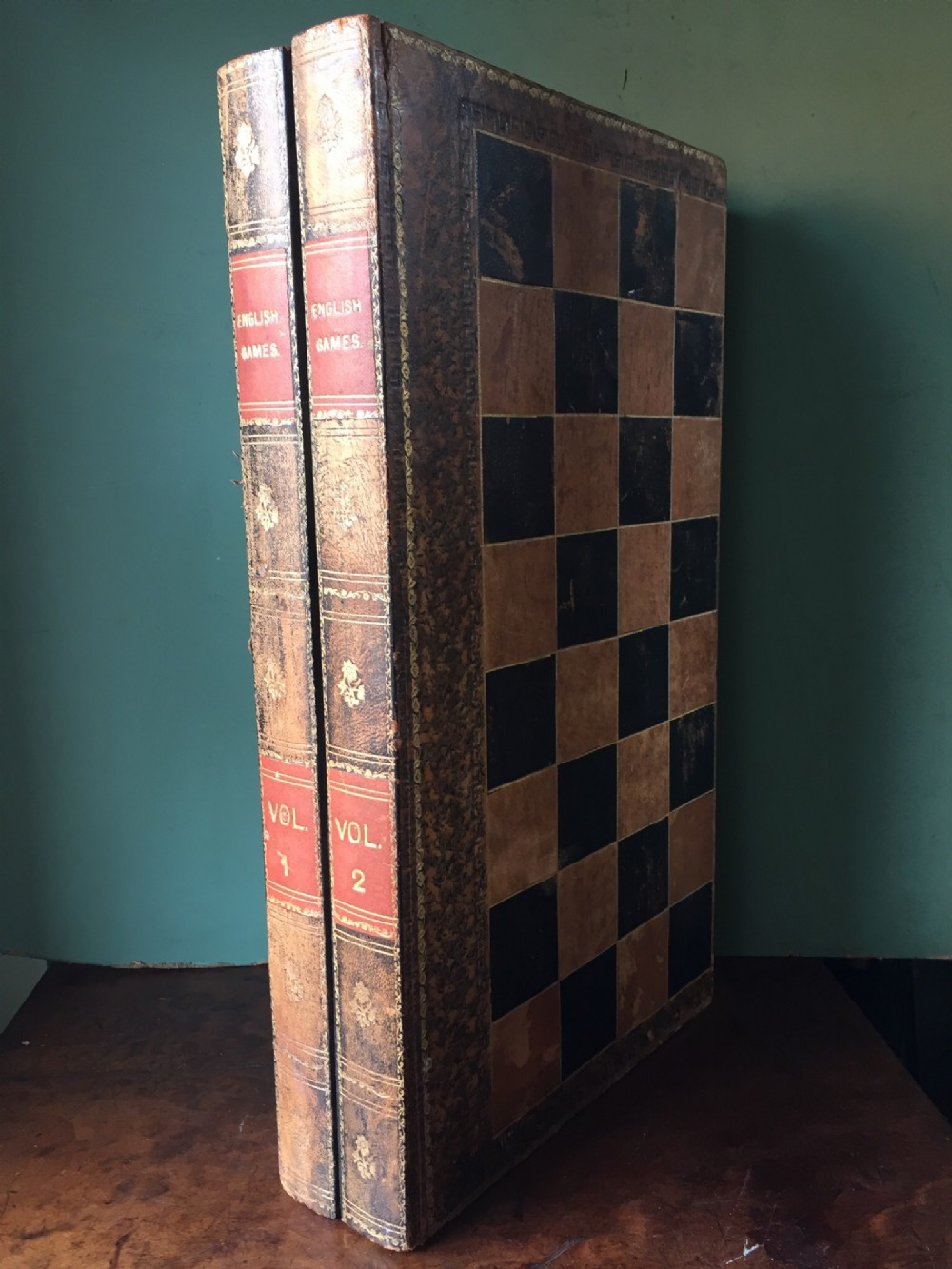 early c20th leatherbound folding games board modelled as 2 volumes of books