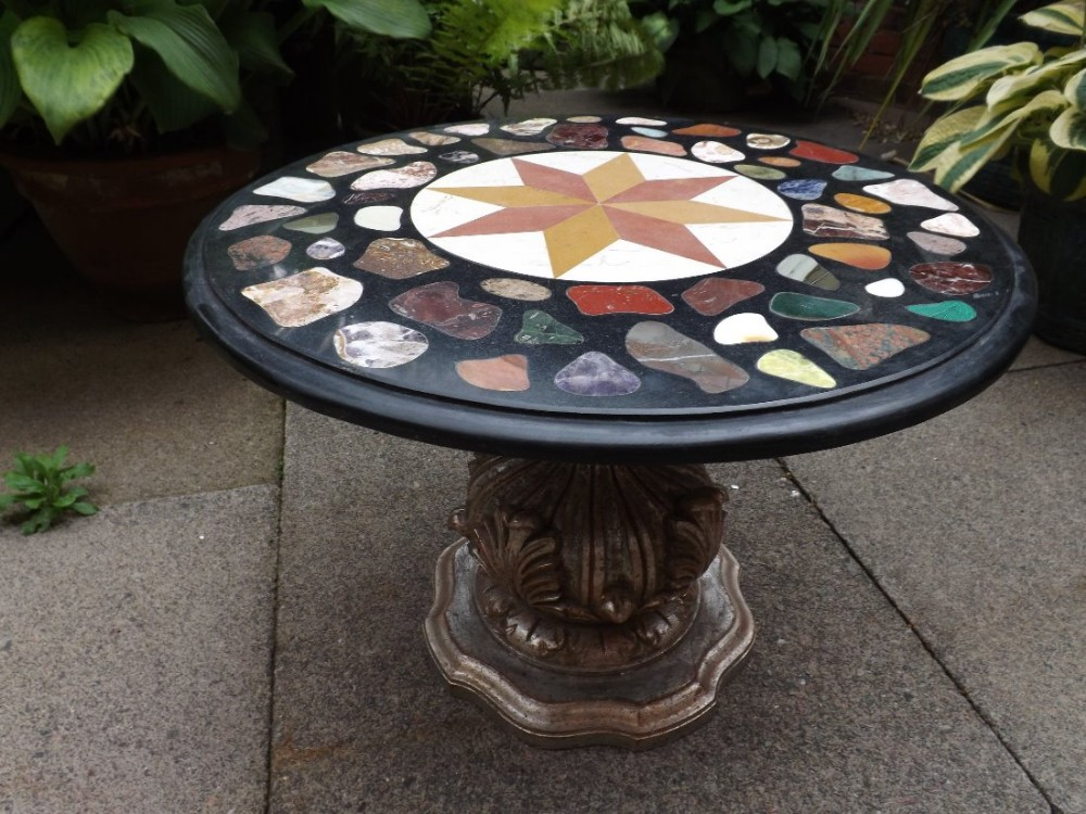 early c20th specimen marble inlaid circular occasional table on carved and silvered giltwood base