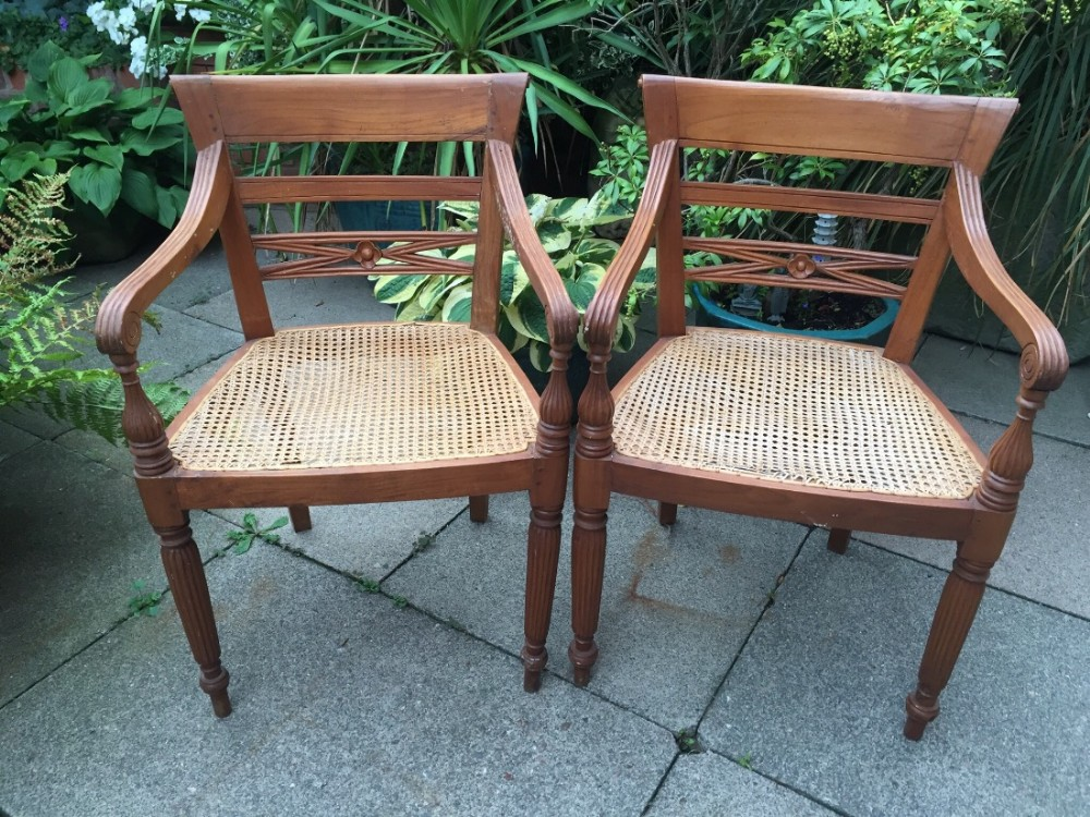pair of early c20th dutch colonial style teak armchairs of early c19th design
