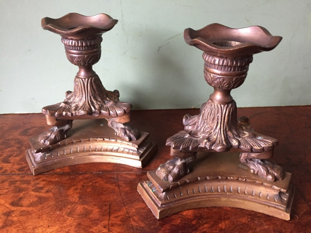 pair of early c19th regency period cast gilded bronze miniature candlesticks