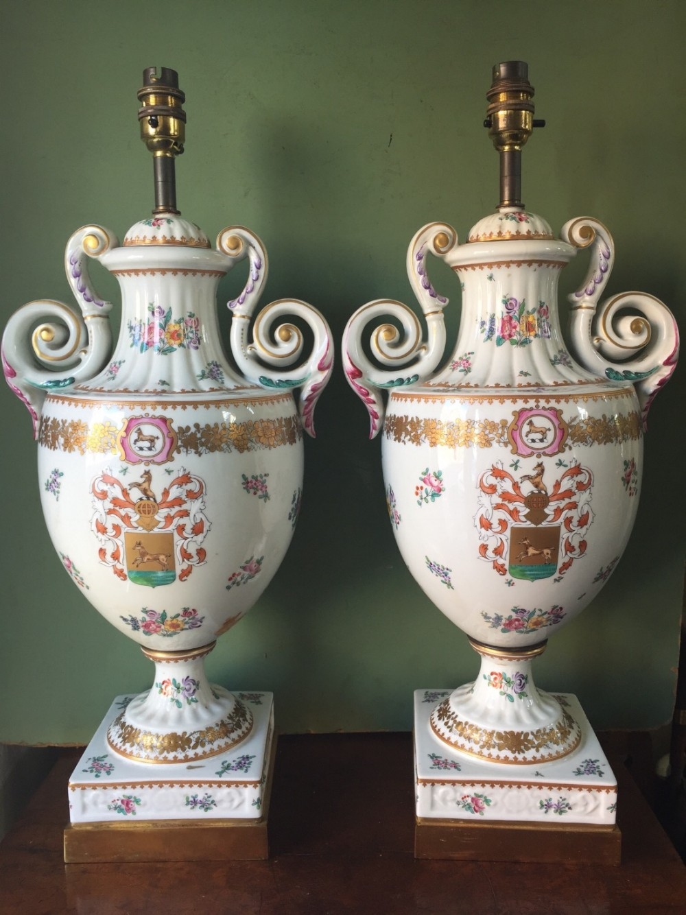 large pair of early c20th chinese armorial style porcelain lamps probably by samson of paris