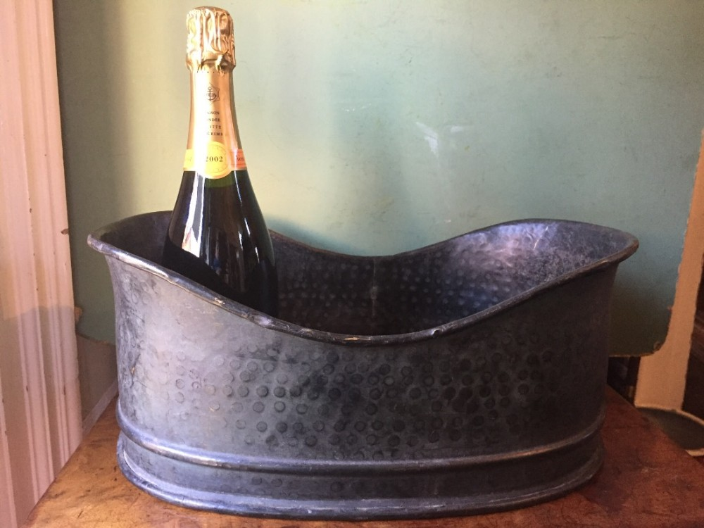 c19th patinated brass winecooler with 'hammered' decoration