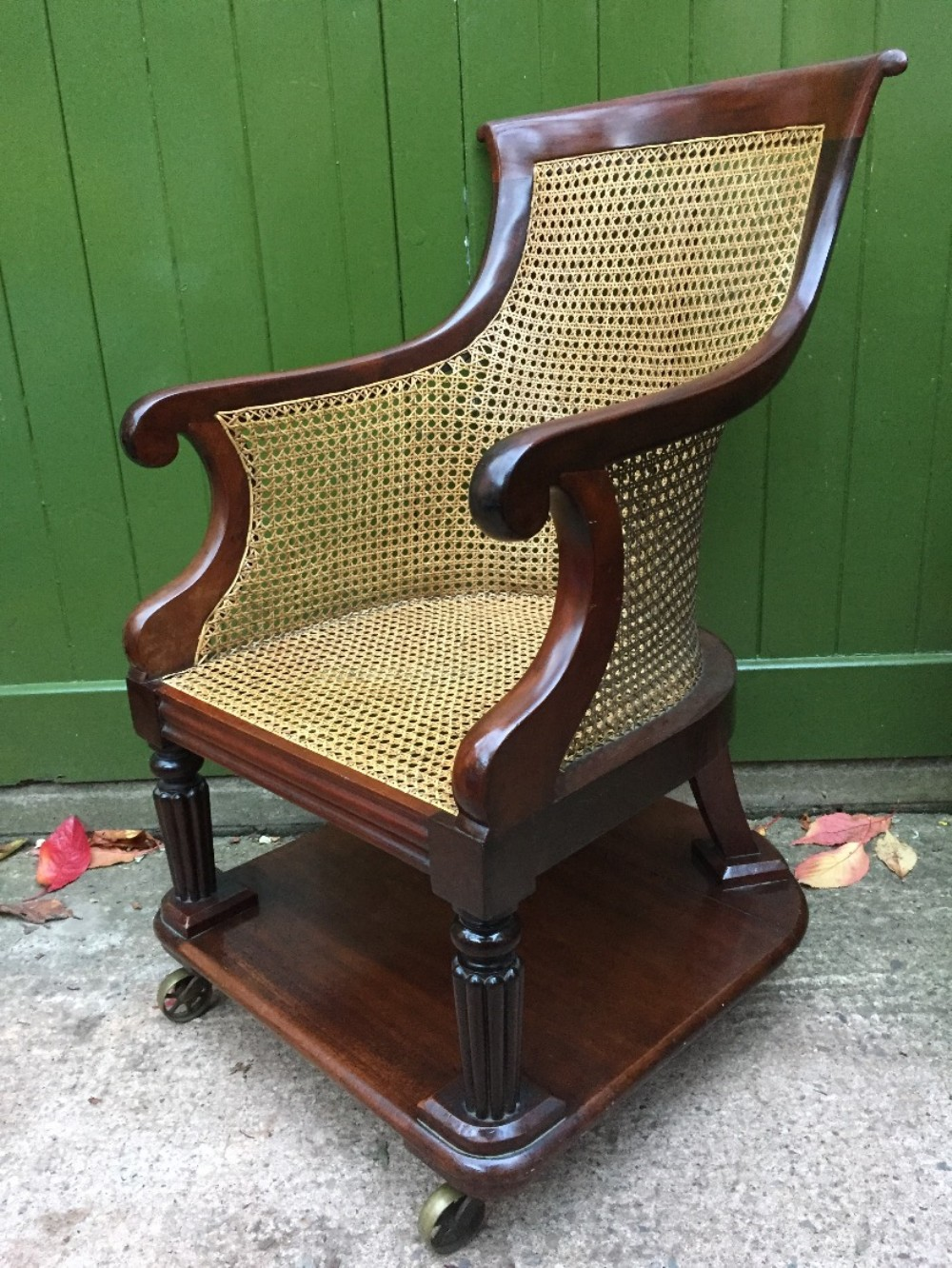 early c19th george iv period mahogany framed gentlemans bergere library or desk armchair of rare form