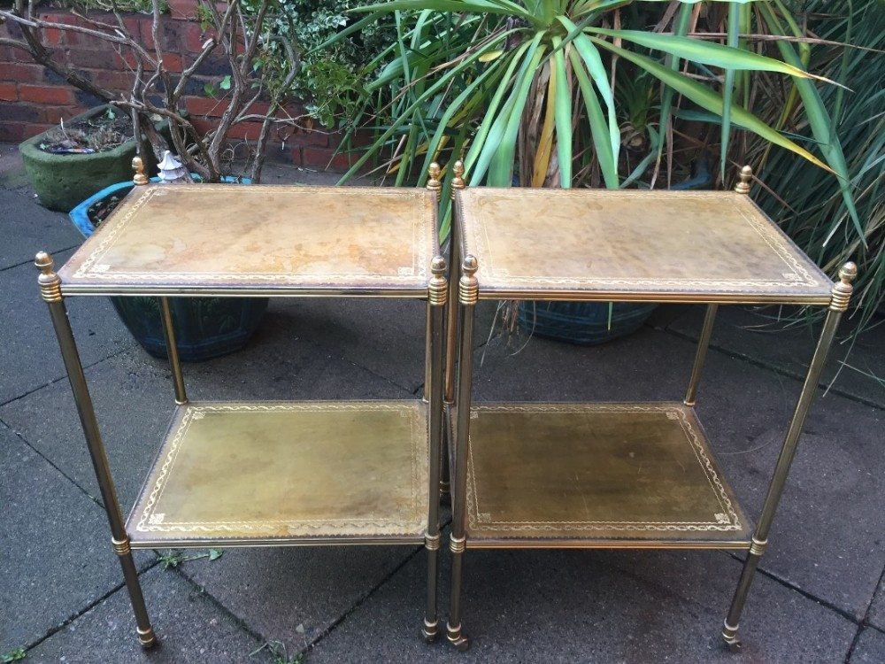 pair of early c20th lacquered tubular brassframed leathertopped 2tier etageres