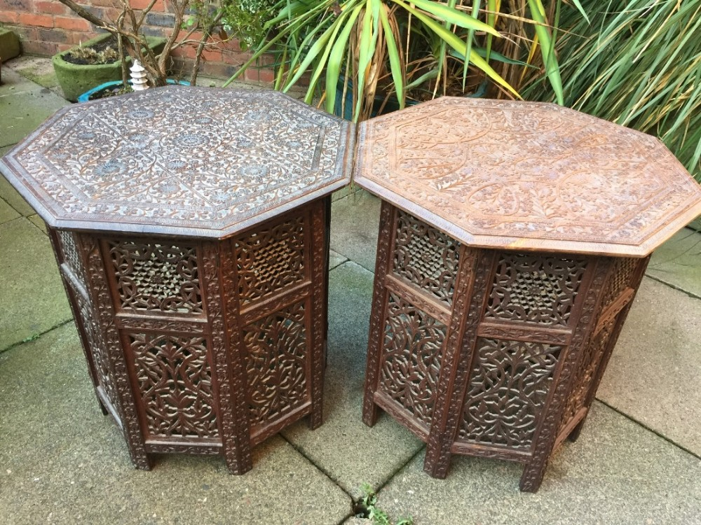 matched 'pair' of late c19th angloindian carved shisham octagonal tables on folding bases