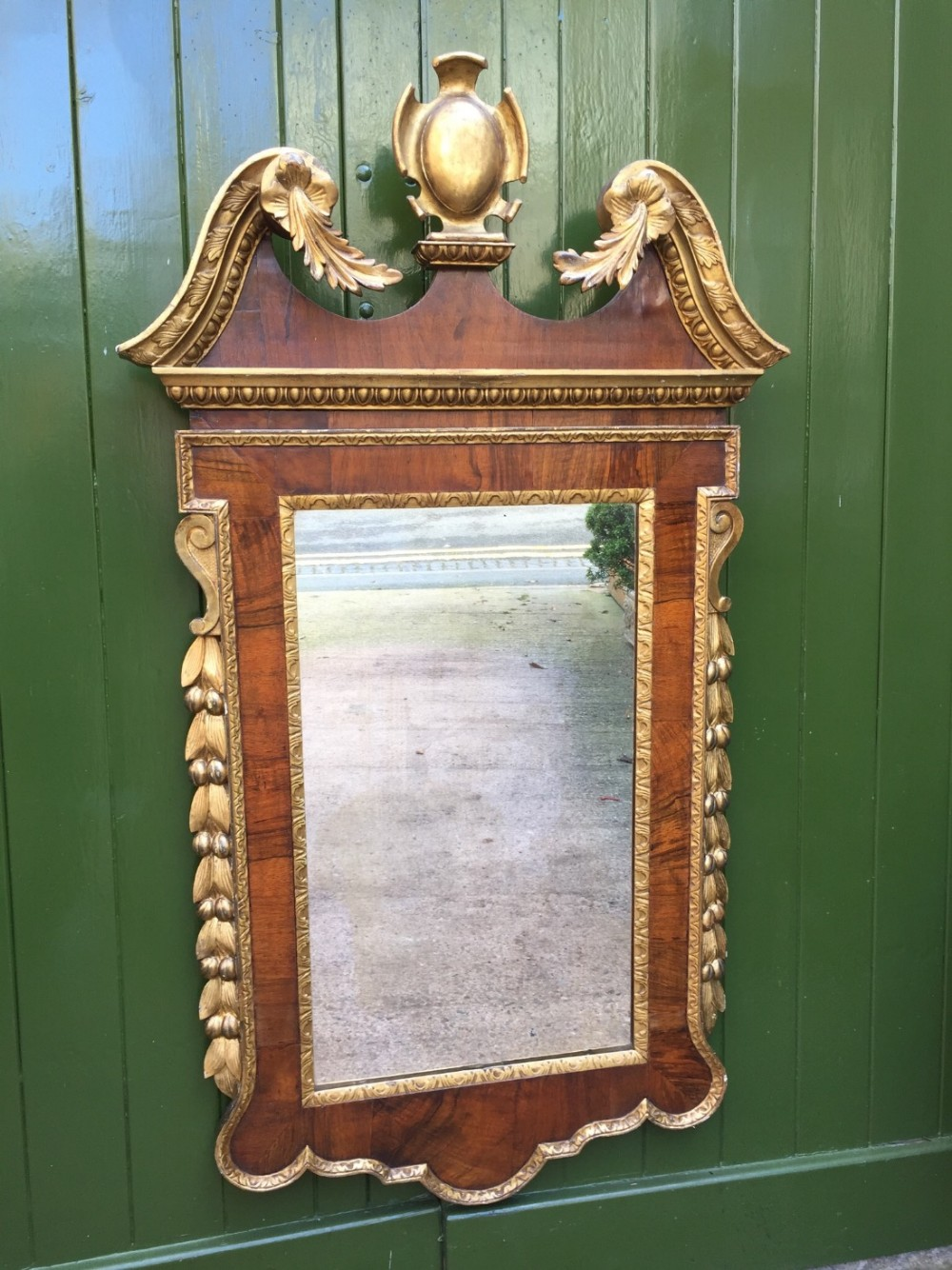 c18th george ii period walnut and carved 'parcel' gilt framed mirror of palladian design