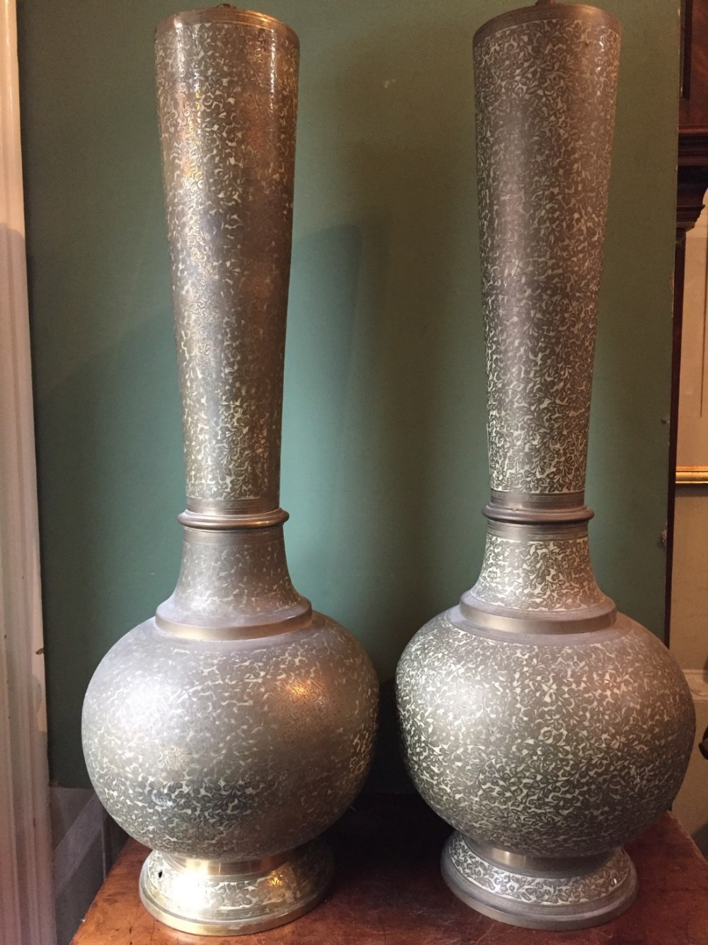 pair late c19th early c20th middle eastern probably egyptian brass lampbases with engraved leaf decoration on an enamelled body