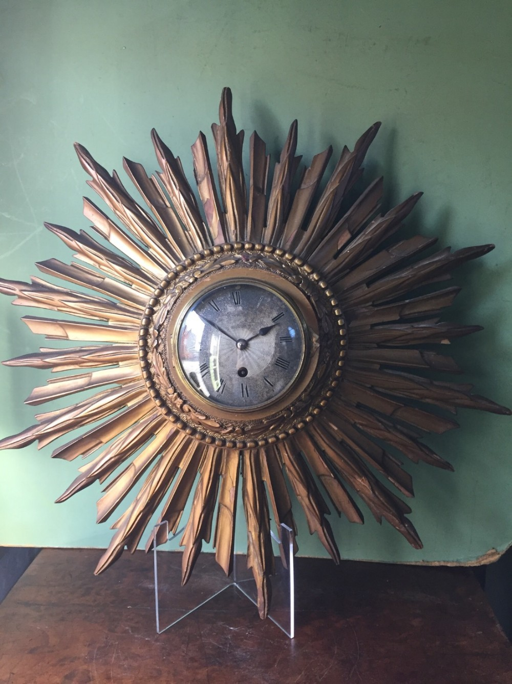 early c20th french giltwood sunburst clock with silvered dial