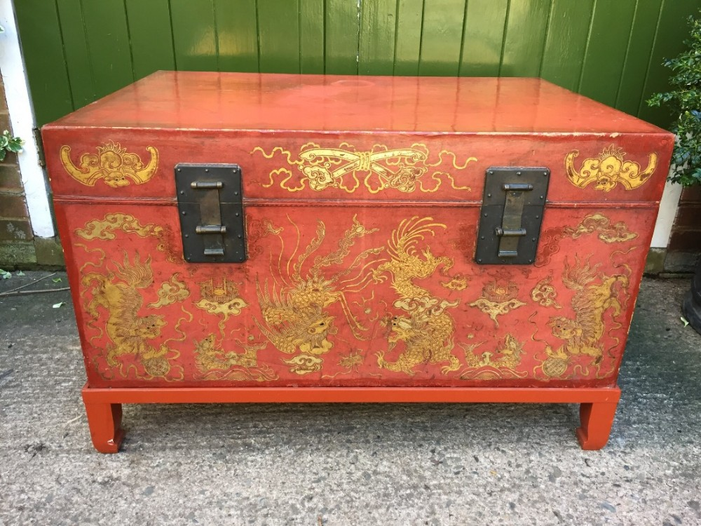 late c19th early c20th chinese red painted and lacquered leather chest or trunk on stand with gilt decoration